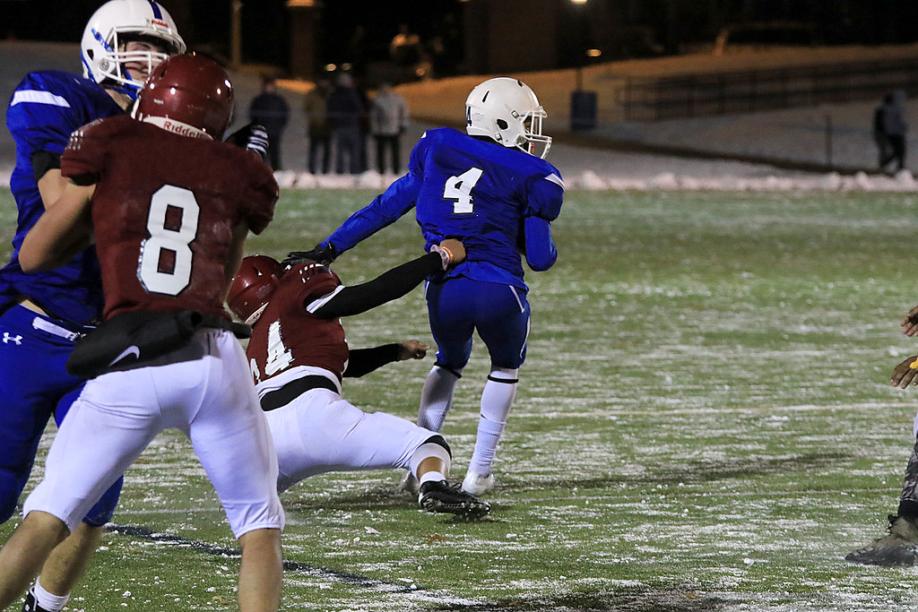 . The Thanksgiving day game with Leominster High School vs Fitchburg High School was played at  Doyle Field in Leomiinster on Wednesday night, November 21, 2018. LHS\'s Brian Rodriquez Looks for an opening in the FHS defense as FHS\'s Henry Yang holds onto him. SENTINEL & ENTERPRISE/JOHN LOVE