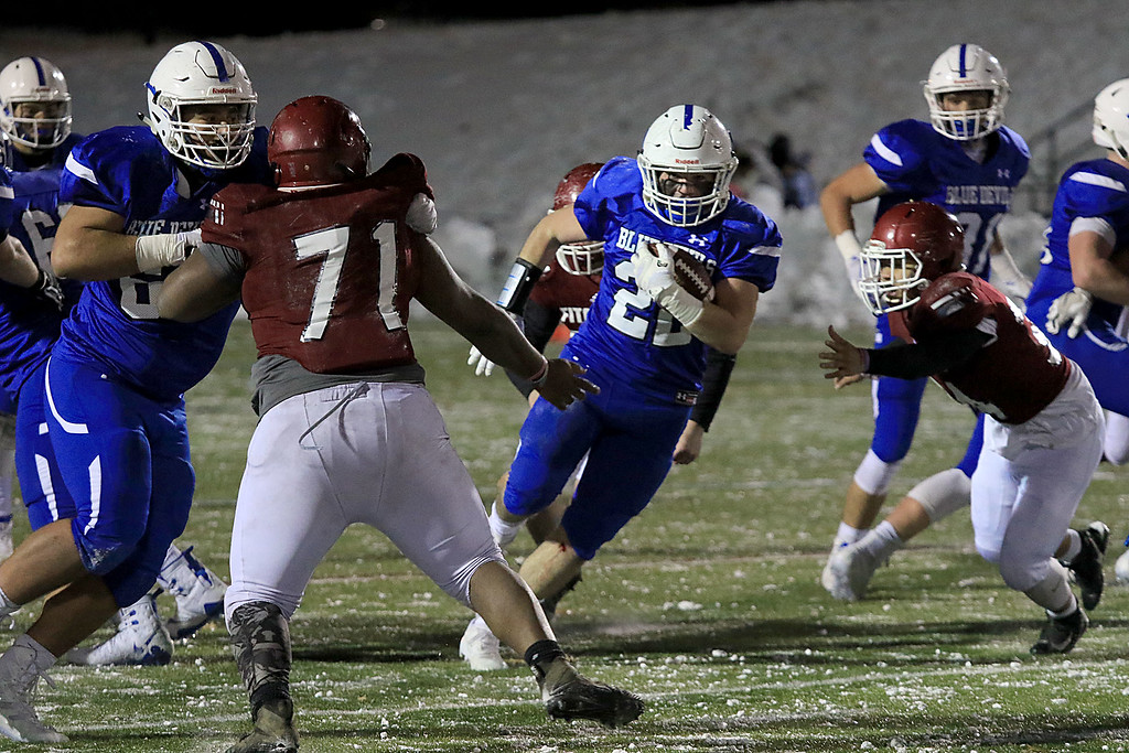 . The Thanksgiving day game with Leominster High School vs Fitchburg High School was played at  Doyle Field in Leomiinster on Wednesday night, November 21, 2018. LHS\'s Connor Marchard finds a hole in FHS\'s defense. SENTINEL & ENTERPRISE/JOHN LOVE