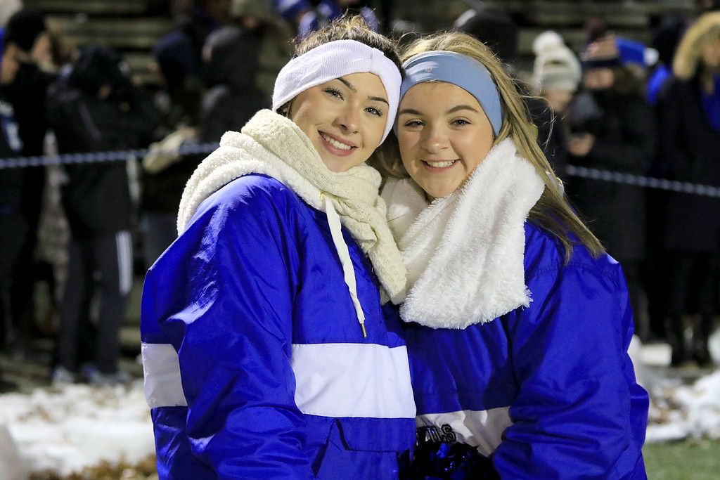 . The Thanksgiving day game with Leominster High School vs Fitchburg High School was played at  Doyle Field in Leomiinster on Wednesday night, November 21, 2018. LHS cheerleaders Alyah Bones Laura Campos are all smiles during the game. SENTINEL & ENTERPRISE/JOHN LOVE