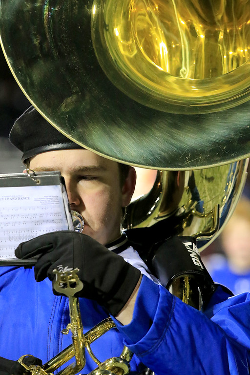 . Littleton High School visited Ayer Shirley Regional High School on Thanksgiving Day for there annual turkey day game. LHS sophomore Eric McCuster playes the sousaphone during the halftime show. SENTINEL & ENTERPRISE/JOHN LOVE
