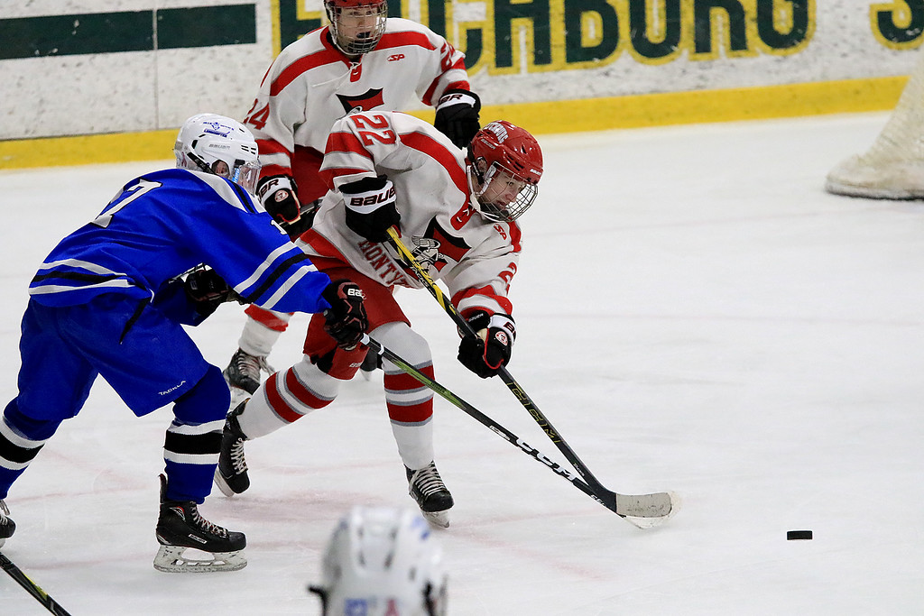 . Fitchburg/Monty Tech High School Hockey played Leominster High School on Friday afternoon at Fitchburg State University\'s Wallace Civic Center. LHS\'s Jeremy Maillet reaches to try and stop FHS/Monty Tech\'s Devin Leblanc from clearing the puck. SENTINEL & ENTERPRISE/JOHN LOVE
