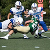 Nashoba Regional High School football played Leominster High School on Saturday afternoon, Sept. 28, 2019  in Bolton during the Ken Tucker Memorial Game. NRHS's #22 Aidan Lee is taken down by LHS #5 LT Curtin. SENTINEL & ENTERPRISE/JOHN LOVE