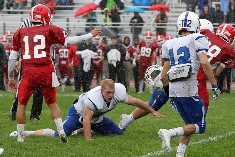 Leominster's Anthony Dandini loses his helmet after colliding with a St. John's player during a game in Shrewsbury on Saturday, Oct. 22, 2016. St. John's won, 35-0. SENTINEL & ENTERPRISE / SCOTT LAPRADE