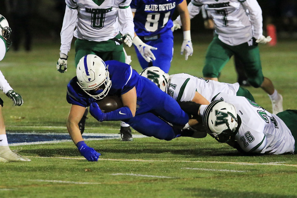 . Leominster senior captain Connor Marchand is pulled down by Wachusett defense in Friday night\'s football match up between Wachusett and Leominster at Doyle Field.  SENTINEL & ENTERPRISE/JOHN LOVE