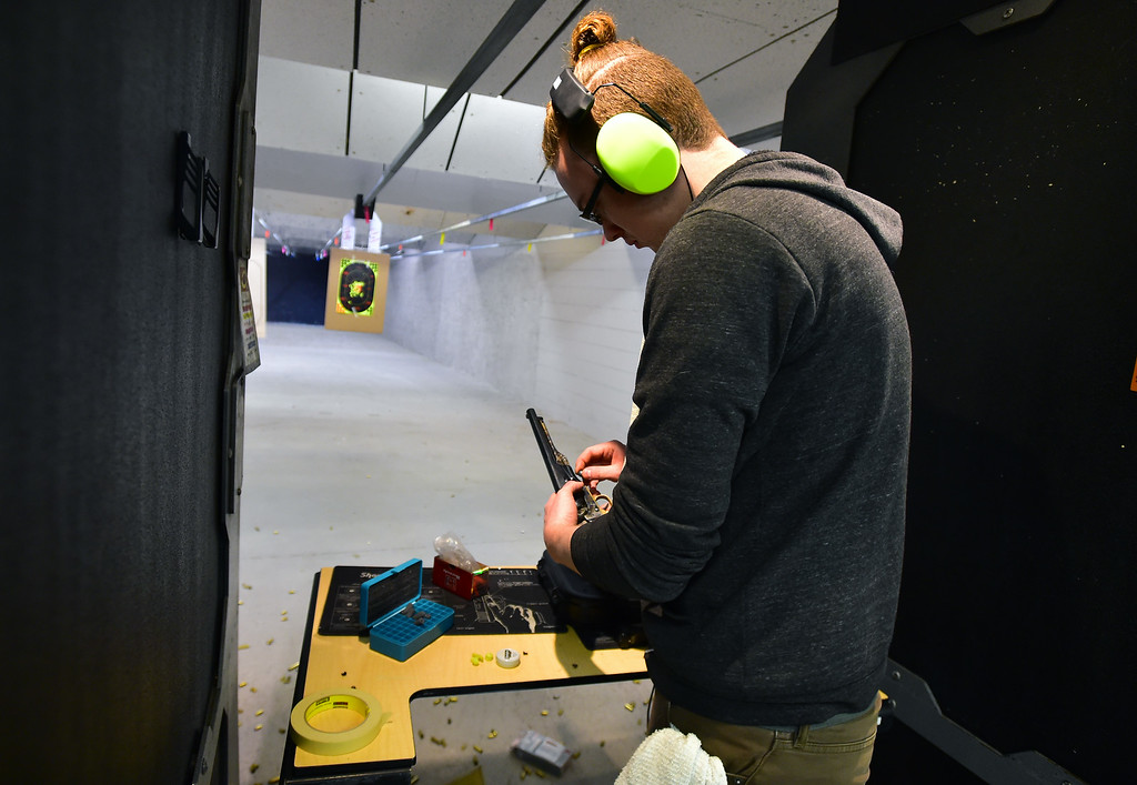 . Benjamin Farmer, loads up his black powder gun, during the Flatirons Sights shooting group\'s shooting session at the Shoot Indoors range in Broomfield on Sunday February 4, 2018.  For more photos and a video go to dailycamera.com Paul Aiken / Staff Photographer / Feb 4, 2018