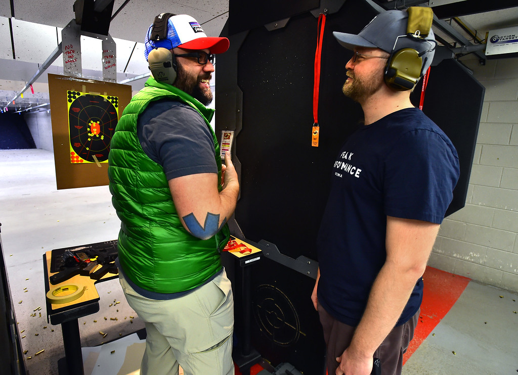 . Fernando Rebora, left, and Nico Dattels chat about Rebora\'s target shooting during the Flatirons Sights shooting group\'s shooting session at the Shoot Indoors range in Broomfield on Sunday February 4, 2018.  For more photos and a video go to dailycamera.com Paul Aiken / Staff Photographer / Feb 4, 2018