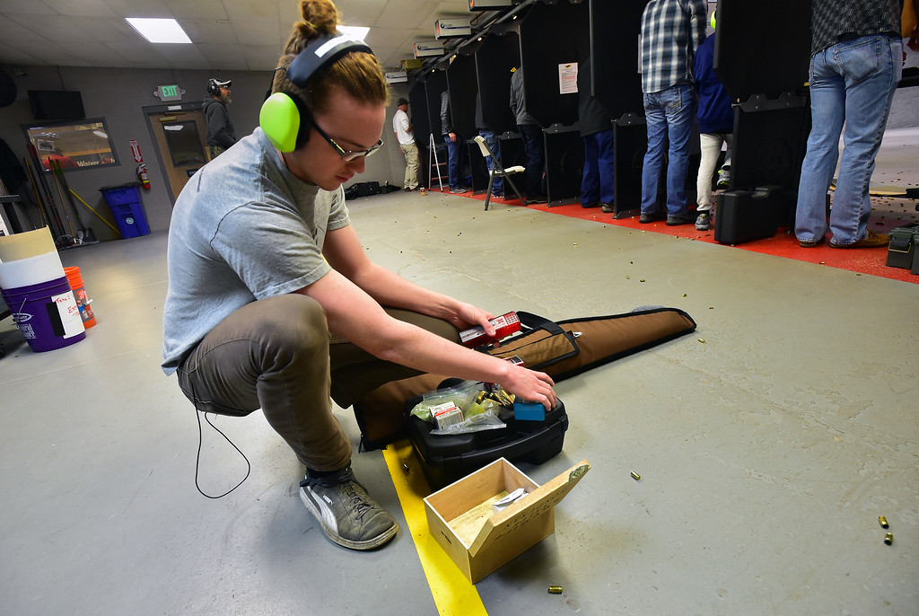 . Benjamin Farmer organizes his equipment during the Flatirons Sights shooting group\'s shooting session at the Shoot Indoors range in Broomfield on Sunday February 4, 2018.  For more photos and a video go to dailycamera.com Paul Aiken / Staff Photographer / Feb 4, 2018