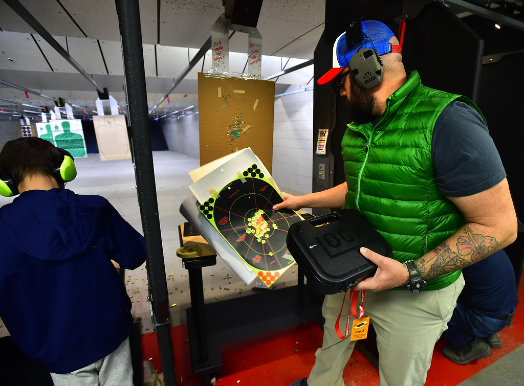 . Fernando Rebora checks out his targets during the Flatirons Sights shooting group\'s shooting session at the Shoot Indoors range in Broomfield on Sunday February 4, 2018.  For more photos and a video go to dailycamera.com Paul Aiken / Staff Photographer / Feb 4, 2018