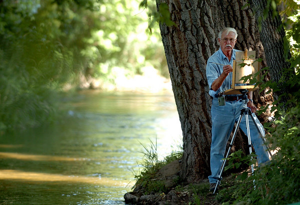 """Artist Bill Weakley works on a picture for the Boulder County Arts Alliance.<br /> Farmers have started supplementing their incomes with pumpkin patches, corn maizes, classes, weddings and more.<br /> For more photos and video from the Lyons Farmette, go to  <a href=""""http://www.dailycamera.com"""">http://www.dailycamera.com</a>.<br /> Cliff Grassmick / August 13, 2010"""