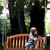 "Max Pfeiffer, 9, takes a break in a swinging chair at the Lyons Farmette.<br /> Farmers have started supplementing their incomes with pumpkin patches, corn maizes, classes, weddings and more.<br /> For more photos and video from the Lyons Farmette, go to  <a href=""http://www.dailycamera.com"">http://www.dailycamera.com</a>.<br /> Cliff Grassmick / August 13, 2010"