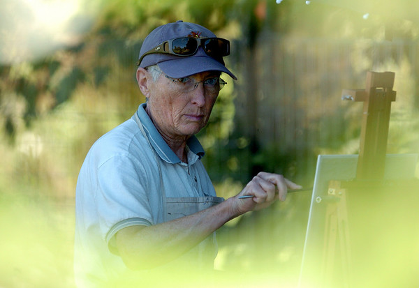 """Margaret Jensen paints sunflowers in a landscape piece.<br /> Farmers have started supplementing their incomes with pumpkin patches, corn maizes, classes, weddings and more.<br /> For more photos and video from the Lyons Farmette, go to  <a href=""""http://www.dailycamera.com"""">http://www.dailycamera.com</a>.<br /> Cliff Grassmick / August 13, 2010"""