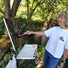 """Carol Rufenach paints a piece for the Boulder County Arts Alliance at the Lyons Farmette.<br /> Farmers have started supplementing their incomes with pumpkin patches, corn maizes, classes, weddings and more.<br /> For more photos and video from the Lyons Farmette, go to  <a href=""""http://www.dailycamera.com"""">http://www.dailycamera.com</a>.<br /> Cliff Grassmick / August 13, 2010"""