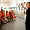 "CLAY<br /> Amy Guion Clay, right, talks about her experiences as an artist in residence in various countries around the world during the opening of her exhibit, ""The Far Shores of Being,"" at the Dairy Center for the Arts on Friday.<br /> Photo by Marty Caivano/July 18, 2011"