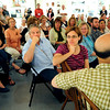 "CLAY<br /> Jim Cunningham, center foreground, and Emily Cosmos, right foreground, listen as Amy Guion Clay, talks about her experiences as an artist in residence in various countries around the world during the opening of her exhibit, ""The Far Shores of Being,"" at the Dairy Center for the Arts on Friday.<br /> Photo by Marty Caivano/July 18, 2011"