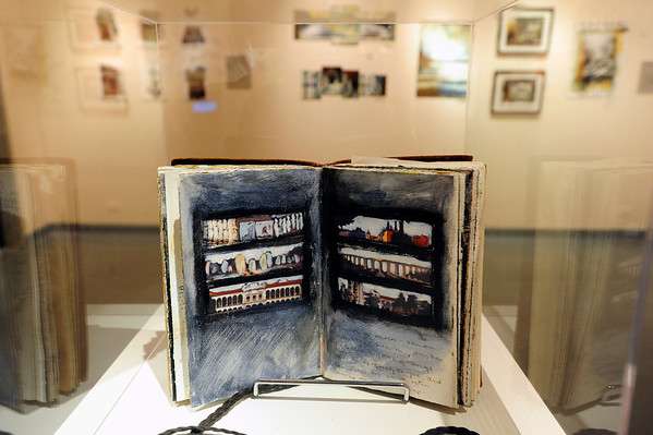 CLAY<br /> Amy Guion Clay's logbook from her travels.<br /> Photo by Marty Caivano/July 18, 2011