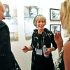 "CLAY<br /> Amy Guion Clay, center, talks with Heather Dupre, left, and Sandy Sincek  during the opening of her exhibit, ""The Far Shores of Being,"" at the Dairy Center for the Arts on Friday.<br /> Photo by Marty Caivano/July 18, 2011"