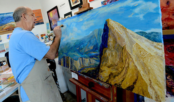 "Paul Riederer works on a landscape. He is one of the artists at the Art/Work/Space in Boulder.<br /> For more photos and a video of the art space, go to  <a href=""http://www.dailycamera.com"">http://www.dailycamera.com</a>.<br /> Cliff Grassmick  / September 5, 2012"