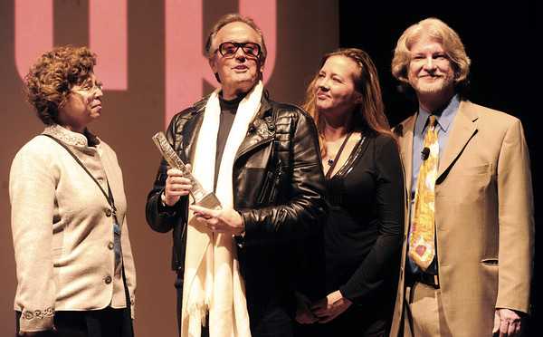 "Peter Fonda accepts the Pinnacle Award from Kathy Beeck, left, Festival Director, Robin Beeck, Executive Director, and Ron Bostwick, Special Event Producer.<br /> The closing night of the 2013 Boulder International Film Festival featured an interview with Peter Fonda.<br /> For more photos and a video of Peter Fonda, go to  <a href=""http://www.dailycamera.com"">http://www.dailycamera.com</a>.<br />  Cliff Grassmick  / February 17, 2013"