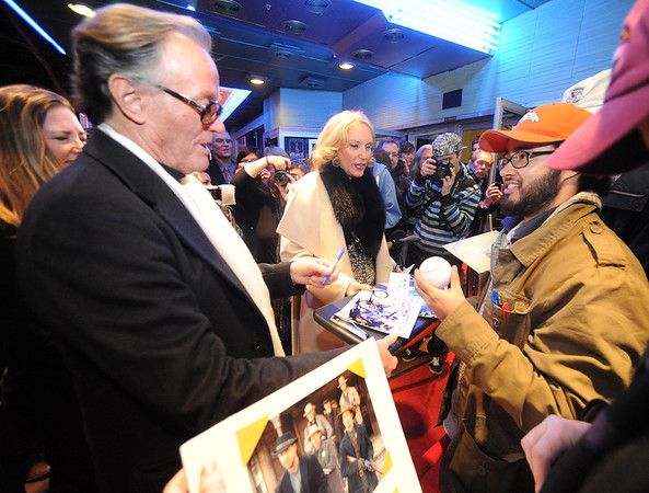 "Peter Fonda and signs photographs with his wife Parky, as they enter the Boulder Theater on Sunday night. Mariano Velasco, right, asks him to sign a baseball.<br /> The closing night of the 2013 Boulder International Film Festival featured an interview with Peter Fonda.<br /> For more photos and a video of Peter Fonda, go to  <a href=""http://www.dailycamera.com"">http://www.dailycamera.com</a>.<br />  Cliff Grassmick  / February 17, 2013"