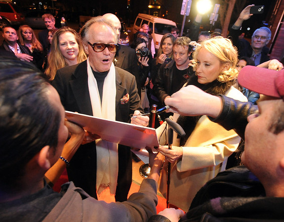 "Peter Fonda and signs photographs with his wife Parky, as they enter the Boulder Theater on Sunday night.<br /> The closing night of the 2013 Boulder International Film Festival featured an interview with Peter Fonda.<br /> For more photos and a video of Peter Fonda, go to  <a href=""http://www.dailycamera.com"">http://www.dailycamera.com</a>.<br />  Cliff Grassmick  / February 17, 2013"