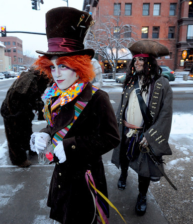 "Adam Jimenez, playing the Mad Hatter, and Ihsah Larsen, playing Jack Sparrow, wait to greet guests outside the Boulderado Hotel.<br /> The stars came out for Opening night of the Boulder International Film Festival on Thursday.<br /> For more photos of the red carpet, go to  <a href=""http://www.dailycamera.com"">http://www.dailycamera.com</a>.<br /> Cliff Grassmick / February 14, 2013"