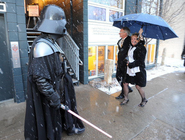 "David Taylor, playing Darth Vader, one of the greeters for the opening night festivities, greets guests Carl Weimer and Kathy Aguer.<br /> The stars came out for Opening night of the Boulder International Film Festival on Thursday.<br /> For more photos of the red carpet, go to  <a href=""http://www.dailycamera.com"">http://www.dailycamera.com</a>.<br /> Cliff Grassmick / February 14, 2013"