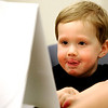 0713PRE4.jpg 0713PRE4.jpg Alex Berryhill, 3, sticks his tongue out in concentration during preschool assessments at the Boulder Valley School District Education Center in Boulder, Colorado July 13, 2011.  CAMERA/Mark Leffingwell