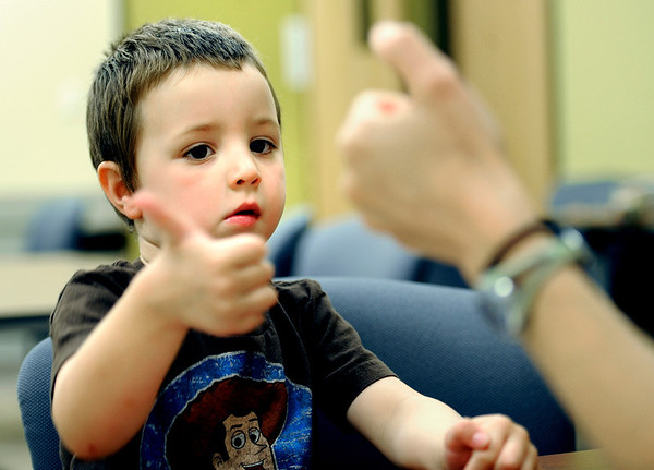 0713PRE3.jpg 0713PRE3.jpg Byron Kofler (left), 3, copies screener Laurie Rhoads (right) thumb movements during preschool assessments at the Boulder Valley School District Education Center in Boulder, Colorado July 13, 2011.  CAMERA/Mark Leffingwell