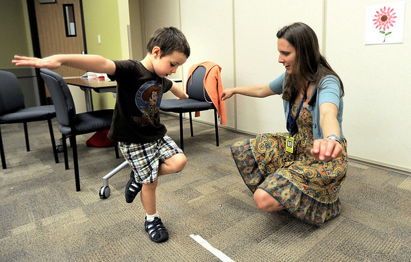 0713PRE1.jpg 0713PRE1.jpg Byron Kofler (left), 3, shows screener Laurie Rhoads (right) how he can stand on one foot and balance during preschool assessments at the Boulder Valley School District Education Center in Boulder, Colorado July 13, 2011.  CAMERA/Mark Leffingwell