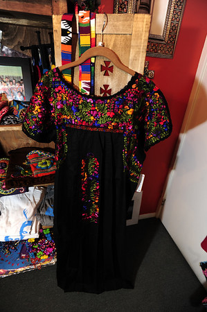 "Black embroidered San Antonino Oaxacan dress, $156, which takes six to nine months to make by hand. Wear it the traditional length or hem it tunic-length and pair with leggings or jeans, cowboy boots and a funky belt to make it more modern.  at Bella Frida | Clothing & folk art de Mexico in Louisville on January 9, 2013. <br /> Photo by Paul Aiken / The Daily Camera / January 8, 2013<br /> fashion<br /> Bella Frida | Clothing & folk art de Mexico<br />  <a href=""http://www.bellafrida.com/Bella"">http://www.bellafrida.com/Bella</a> Frida is a locally owned store in Historic Downtown Louisville, Colorado featuring colorful hand-embroidered clothing and original folk art from Mexico.<br /> Google+ page"