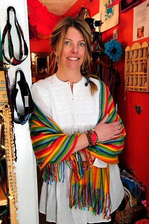 "Bella Frida owner Laura Lambrech with handmade filagree silver earrings from Oaxaca ($140); a striped alpaca shawl from Peru ($42); a hand-embroidered shirt from Chiapas ($96); and a bead, agate and Day of the Dead influenced wrap bracelet made by Leigh Palmer, of Boulder, $48. .<br /> Bella Frida | Clothing & folk art de Mexico in Louisville on January 9, 2013. <br /> Photo by Paul Aiken / The Daily Camera / January 8, 2013<br /> fashion<br /> Bella Frida | Clothing & folk art de Mexico<br />  <a href=""http://www.bellafrida.com/Bella"">http://www.bellafrida.com/Bella</a> Frida is a locally owned store in Historic Downtown Louisville, Colorado featuring colorful hand-embroidered clothing and original folk art from Mexico.<br /> Google+ page"
