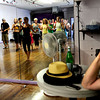 "Gregory Koplow, of Colorado Springs, watches Luciana da Silva, of Colorado Springs instruct a beginners solo samba class in Kakes studio. The samba class is a part of the Colorado Brazil Festival, highlighting different types of dance. August 4, 2012. Rachel Woolf/ For the Daily Camera. For more photos and a video of the class, go to  <a href=""http://www.dailycamera.com"">http://www.dailycamera.com</a>."