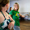 "From left, Emily Hamblen, of Fort Collins dances and smiles with Belita Marine, of Fort Collins, during a beginners solo samba class in Kakes studio taught by Luciana da Silva, of Colorado Springs. The samba class is a part of the Colorado Brazil Festival, highlighting different types of dance. August 4, 2012. Rachel Woolf/ For the Daily Camera. For more photos and a video of the class, go to  <a href=""http://www.dailycamera.com"">http://www.dailycamera.com</a>."
