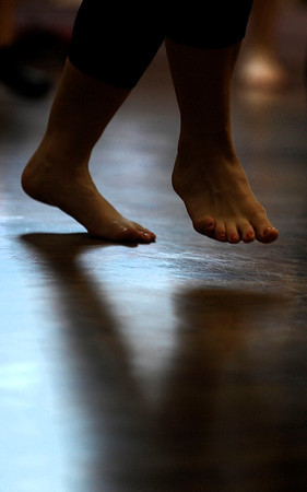 "A dancer's feet jump up during a beginners solo samba class in Kakes studio taught by Luciana da Silva, of Colorado Springs. The samba class is a part of the Colorado Brazil Festival, highlighting different types of dance. August 4, 2012. Rachel Woolf/ For the Daily Camera. For more photos and a video of the class, go to  <a href=""http://www.dailycamera.com"">http://www.dailycamera.com</a>."