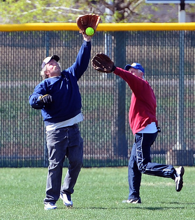 """Paul Madigan, left, and Jim Tolly,  both run to a fly ball<br /> during senior softball practice on April 4, 2012.<br /> For a video and more photos of the team, go to  <a href=""""http://www.broomfieldenterprise.com"""">http://www.broomfieldenterprise.com</a>.<br /> Cliff Grassmick / April 4, 2012"""