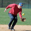 "Jim Tolly runs in to make a catch during senior softball practice on April 4, 2012.<br /> For a video and more photos of the team, go to  <a href=""http://www.broomfieldenterprise.com"">http://www.broomfieldenterprise.com</a>.<br /> Cliff Grassmick / April 4, 2012"