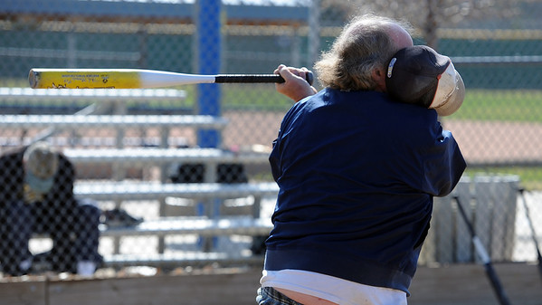 """Paul Madigan swings so hard his hat comes off<br /> during senior softball practice on April 4, 2012.<br /> For a video and more photos of the team, go to  <a href=""""http://www.broomfieldenterprise.com"""">http://www.broomfieldenterprise.com</a>.<br /> Cliff Grassmick / April 4, 2012"""