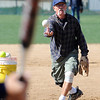 "Mike Scott-Burke pitches batting practice during senior softball practice on April 4, 2012.<br /> For a video and more photos of the team, go to  <a href=""http://www.broomfieldenterprise.com"">http://www.broomfieldenterprise.com</a>.<br /> Cliff Grassmick / April 4, 2012"