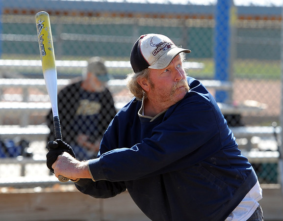 "Paul Madigan prepares to hit the ball during senior softball practice on April 4, 2012.<br /> For a video and more photos of the team, go to  <a href=""http://www.broomfieldenterprise.com"">http://www.broomfieldenterprise.com</a>.<br /> Cliff Grassmick / April 4, 2012"