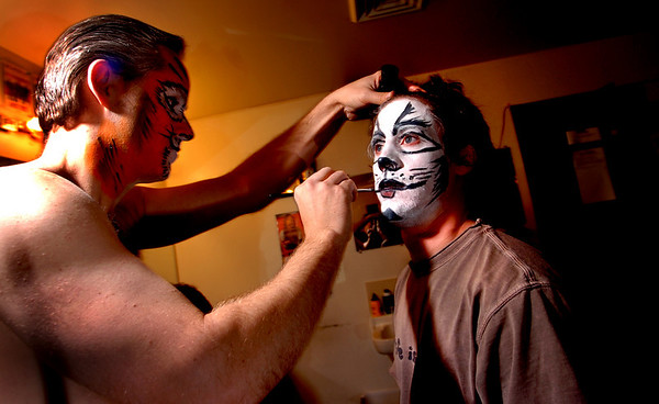 Stephen Bertles, left, who plays Mungojerrie, one of a pair of cat-burglars, helps Benji Tompkins, who plays Mr. Mistoffelees, apply his makeup in the Boulder's Dinner Theatre dressing rooms on Tuesday April 26 2011.