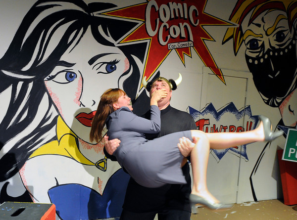 "Erik Wilkins holds Heather Kaskinen in his arms while performing during a Comic Con Con Comedy dress rehearsal on Monday, July 30, at the Mary Miller Theater on E. Simpson Street in Lafayette. For more photos of the rehearsal go to  <a href=""http://www.dailycamera.com"">http://www.dailycamera.com</a><br /> Jeremy Papasso/ Camera"