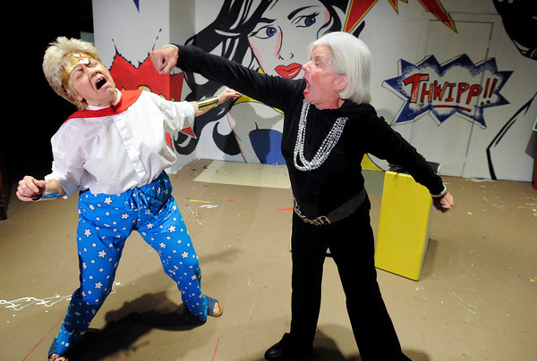 "Vonalda Utterback, left, and Susanne Neswadi perform a fight scene during a Comic Con Con Comedy dress rehearsal on Monday, July 30, at the Mary Miller Theater on E. Simpson Street in Lafayette. For more photos of the rehearsal go to  <a href=""http://www.dailycamera.com"">http://www.dailycamera.com</a><br /> Jeremy Papasso/ Camera"