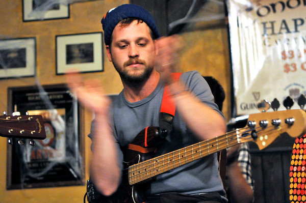 Toby Leaman of  Philadelphia-based band Dr. Dog performs an acoustic set at Conor O'Neil's in Boulder on Tuesday, Oct. 26, 2010. <br /> CAMERON REDWINE / Camera
