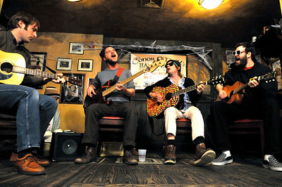 From left, Zach Miller, Toby Leaman, Scott McMicken, and Frank McElroy of  Philadelphia-based band Dr. Dog performs an acoustic set at Conor O'Neil's in Boulder on Tuesday, Oct. 26, 2010.  CAMERON REDWINE / Camera