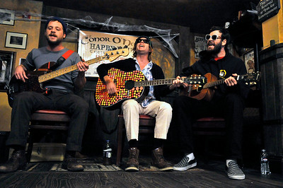 From left, Toby Leaman, Scott McMicken, and Frank McElroy of  Philadelphia-based band Dr. Dog performs an acoustic set at Conor O'Neil's in Boulder on Tuesday, Oct. 26, 2010.  CAMERON REDWINE / Camera