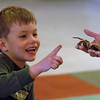 "Aric Olson, 5, gives a high five to the tarantula, held by Jill Dreves.<br /> Emmy winning songwriter, David Williams, is releasing a new CD of songs he wrote with Wild Bear Mountain Ecology Center in Nederland.<br /> For more photos and video, go to  <a href=""http://www.dailycamera.com"">http://www.dailycamera.com</a>.<br /> Cliff Grassmick / December 11, 2010"