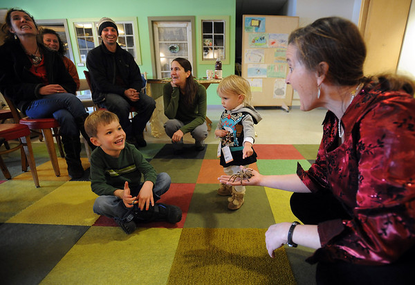 "Jill Dreves of Wild Bear, talks about her tarantula to Aric Olson, 5, and River Lemaster, 18-months,  among others.<br /> Emmy winning songwriter, David Williams, is releasing a new CD of songs he wrote with Wild Bear Mountain Ecology Center in Nederland.<br /> For more photos and video, go to  <a href=""http://www.dailycamera.com"">http://www.dailycamera.com</a>.<br /> Cliff Grassmick / December 11, 2010"