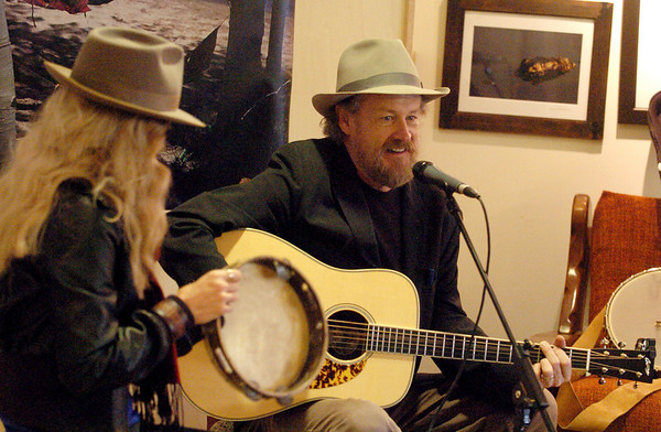 """Karen Carroll, left, and David Williams perform the """"Wild Bear"""" song.<br /> Emmy winning songwriter, David Williams, is releasing a new CD of songs he wrote with Wild Bear Mountain Ecology Center in Nederland.<br /> For more photos and video, go to  <a href=""""http://www.dailycamera.com"""">http://www.dailycamera.com</a>.<br /> Cliff Grassmick / December 11, 2010"""