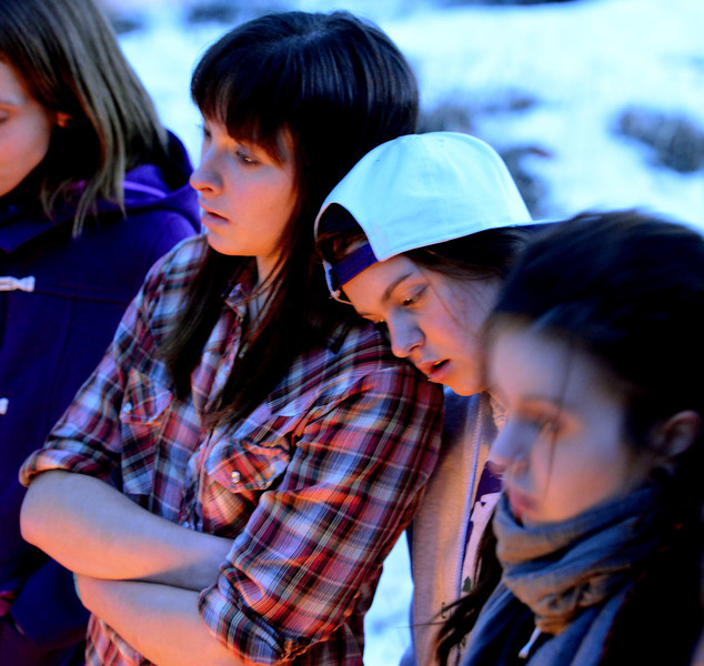 """Tess rests her head on her friend Kayla's shoulder during the initiation ceremony for Claire and Alex at Fire Mountain.<br /> Fire Mountain Sober Home in Boulder is where teens ages 13-17 live for 4-14 months to hit the reset button,<br /> get sober,  get the life skills they need to succeed,<br /> become empowered and develop self-concept, and re-integrate back into their communities as responsible, contributing young adults.<br /> For more photos and a video from Fire Mountain, go to  <a href=""""http://www.dailycamera.com"""">http://www.dailycamera.com</a>.<br /> Cliff Grassmick  / January 4, 2013"""