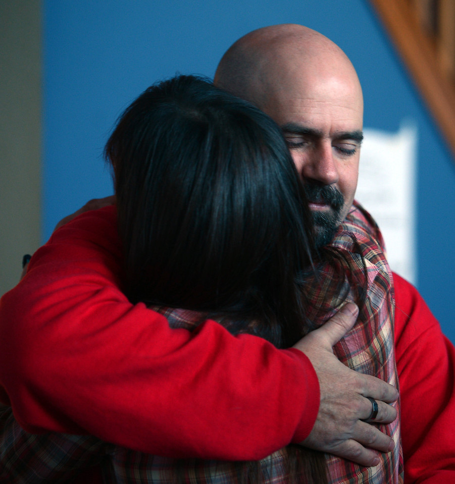 """Former Fire Mountain resident, Kayla, hugs Aaron Huey, the program's founder.<br /> Fire Mountain Sober Home in Boulder is where teens ages 13-17 live for 4-14 months to hit the reset button,<br /> get sober,  get the life skills they need to succeed,<br /> become empowered and develop self-concept, and re-integrate back into their communities as responsible, contributing young adults.<br /> For more photos and a video from Fire Mountain, go to  <a href=""""http://www.dailycamera.com"""">http://www.dailycamera.com</a>.<br /> Cliff Grassmick  / January 4, 2013"""